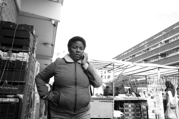 On the phone. Watney Market. East London 2017.