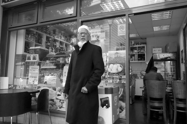 Man outside a shop. Watney Market. East London 2017.