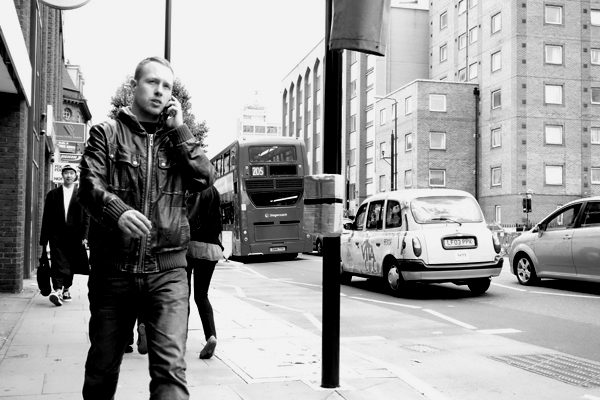 On the phone. Whitechapel 2015.