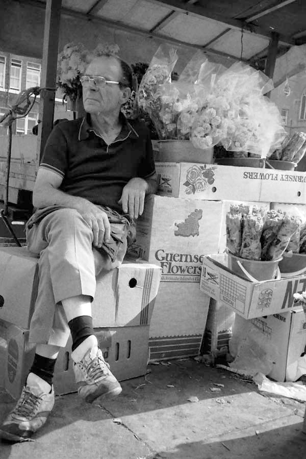 Flower seller. Whitechapel market 1986.