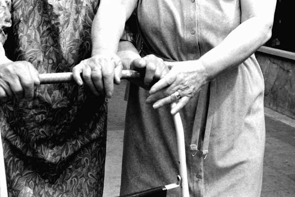 Hands together. Whitechapel market 1985.