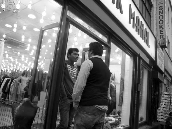 Conversation. Whitechapel market 2010.