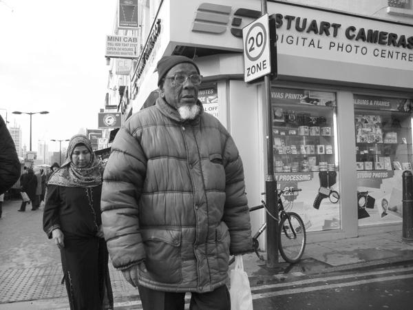 Man with glasses. Whitechapel market 2010.