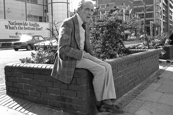 Man on a wall. Aldgate East. London 1984.