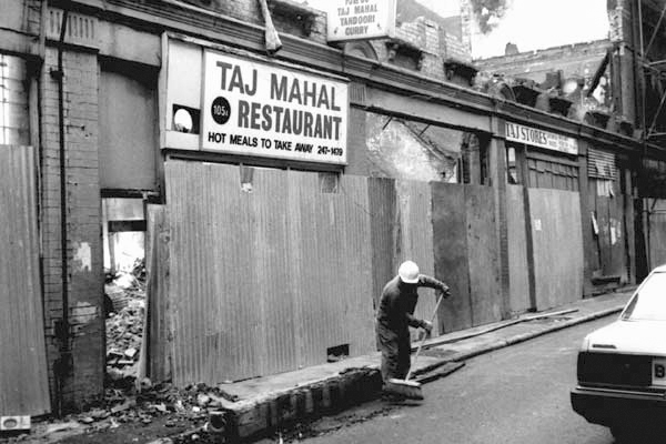 Cleaning up. Brick Lane. East London 1984.