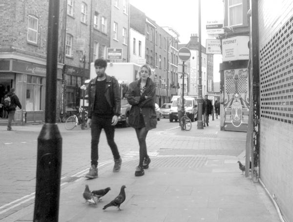 Pigeons & pedestrians. Brick Lane 2010.