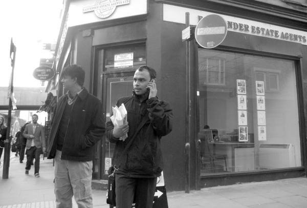 Conversation on the phone. Brick Lane 2010.