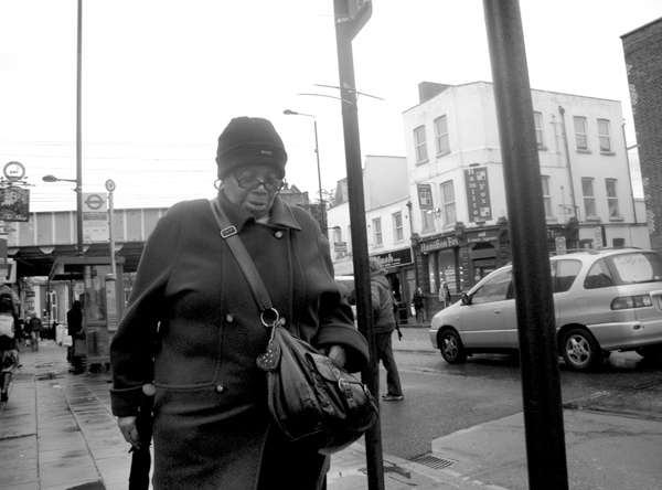Woman with a woolen hat. Bethnal Green Road 2010.