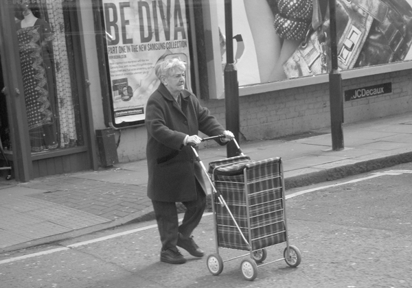 Woman with a trolley bag. Bethnal Green Road 2010.