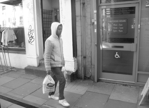 Man in a hood. Bethnal Green Road 2010.