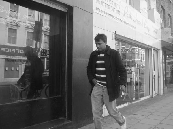 Man with a cigarette. Brick Lane 2010.