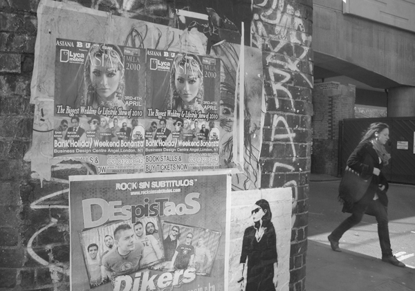 Posters on the wall. Brick Lane 2010.