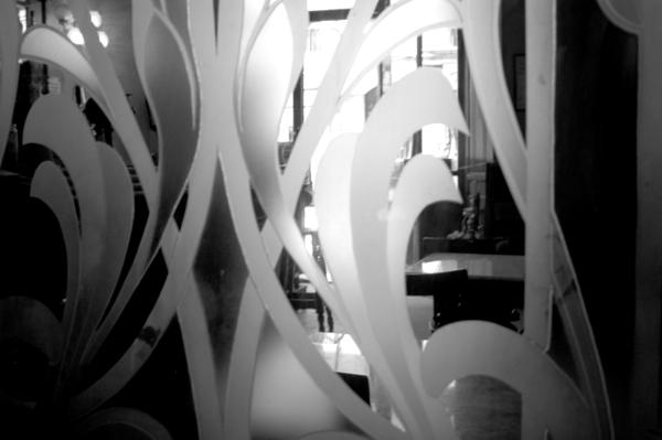 Glass screen inside a bar. Barcelona 2005.