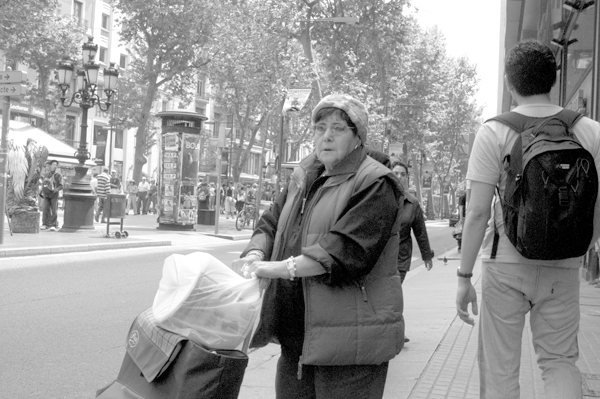 Woman with a shopping trolley. Barcelona 2005.