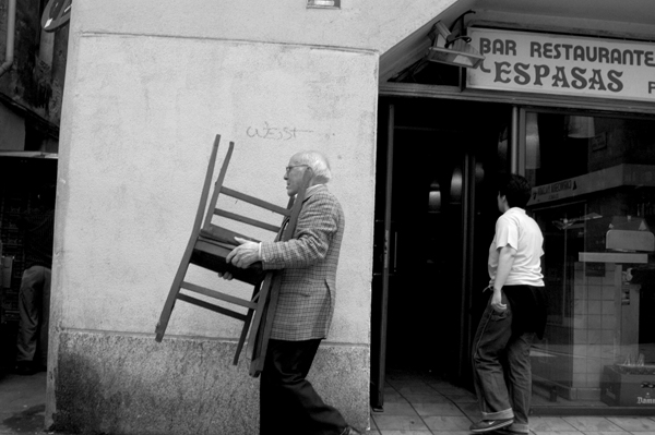 Man carrying chairs. Barcelona 2015.