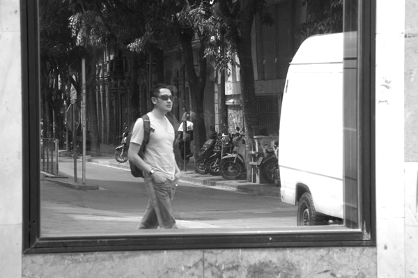 Hazuan walking past a mirror in the street. Barcelona 2015.
