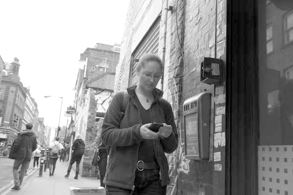 On the phone. Hanbury Street East London 2014.