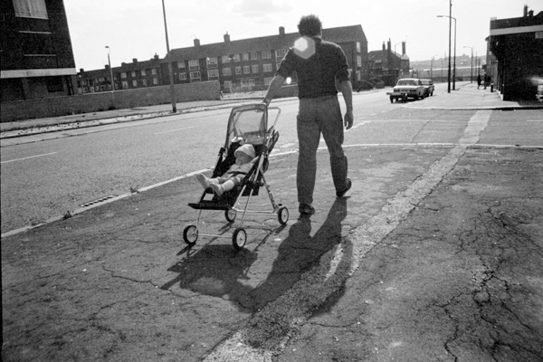 Man with a push chair. The Dingle. Liverpool 1979.