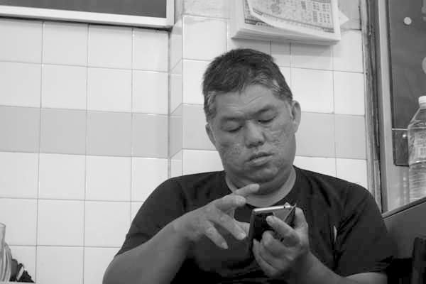 Man in a restaurant. Melaka, Malaysia 2017.