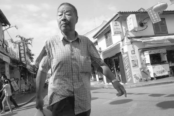 Man on the street. Melaka, Malaysia 2017.