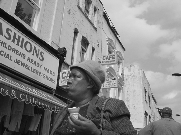 Woman with an ice cream. Whitechapel 2004.
