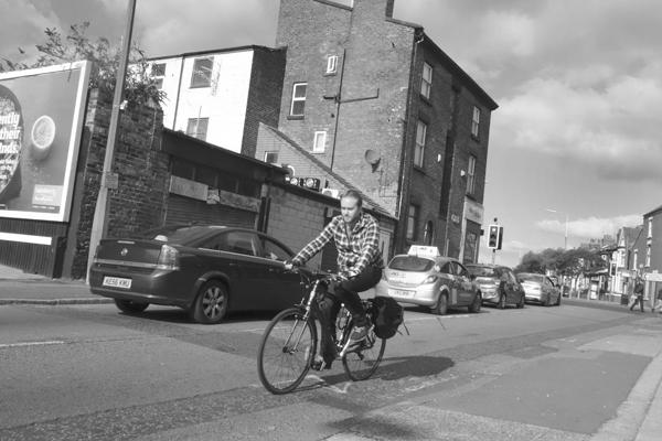 Man on a bike. Wellington Road. Wavertree 2016.