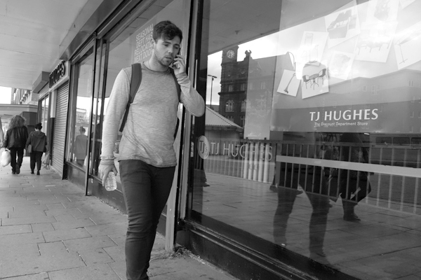 On the phone. London road. Liverpool 2017.