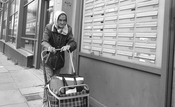 Woman with a trolley bag London road. Liverpool 2017.