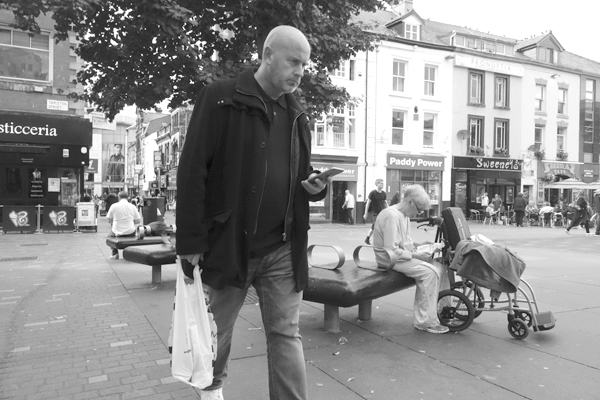 Checking the phone. Clayton Square. Liverpool 2017.