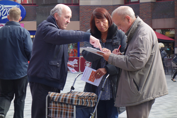 Collecting signatures. Clayton Square, Liverpool 2017.