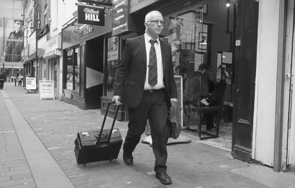 Man with a trolley bag. Liverpool September 2017.