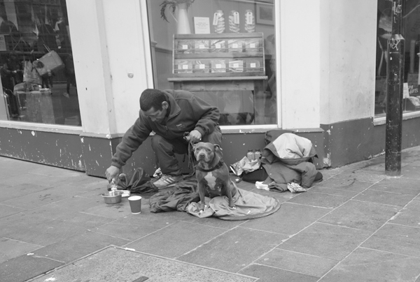 Homeless man taking care of his dog. Liverpool September 2017.