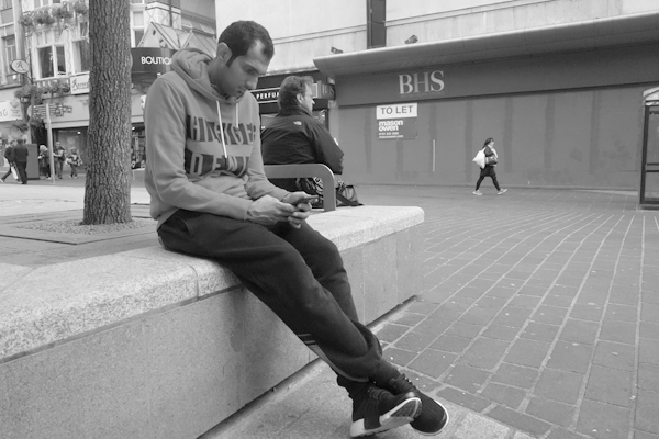 On the phone in Church Street. Liverpool September 2017.