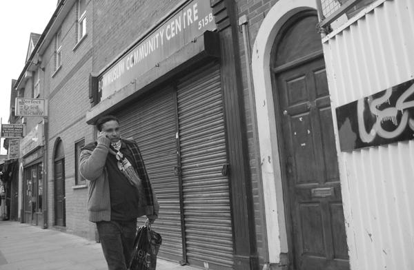 On the phone. Roman Road, East London 2010.