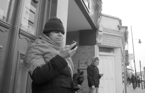Waiting for the bus. Roman Road, East London 2010.