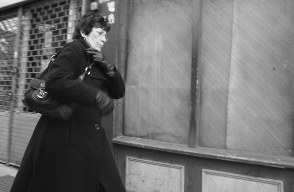 Woman in a hurry. Roman Road, East London 2010.