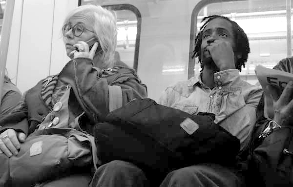 On the phone at a station. London September 2017.
