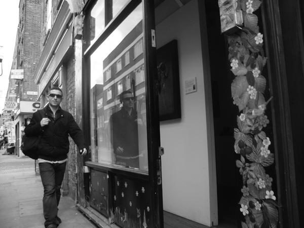 Man wearing sun glasses. Brick Lane 2010.