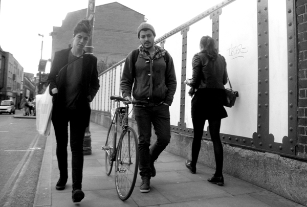 On foot with a bicycle. Brick Lane 2010.