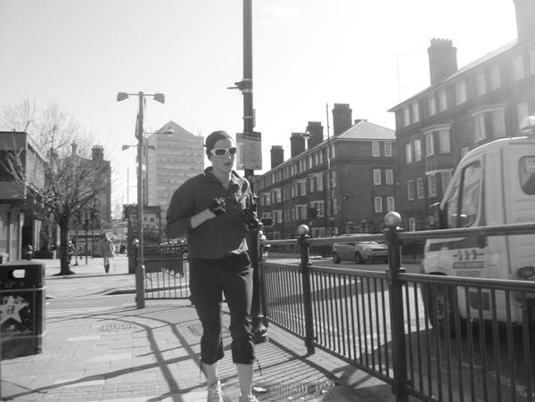Woman wearing sun glasses. Roman Road. East London 2010.
