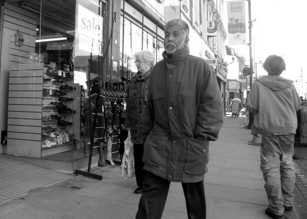 Passing the shoe shop. Roman Road. East London 2010.