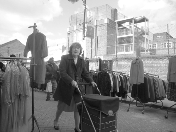 Woman with a shopping trolley. Roman Road. East
