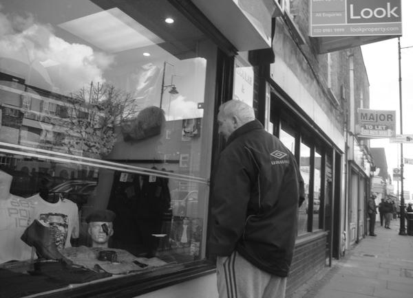 Looking in a shop window. Roman Road. East London 2010.