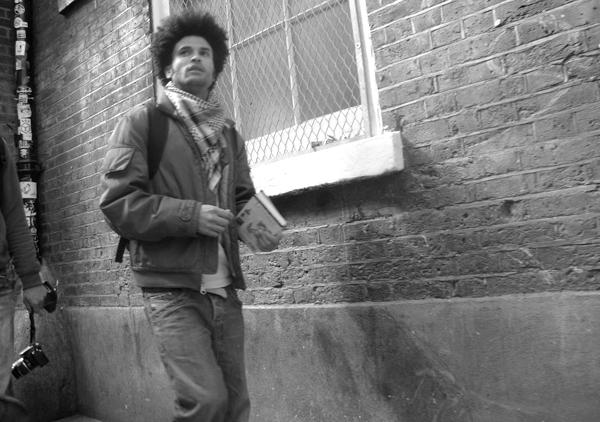 Man with a book. Brick Lane 2010.