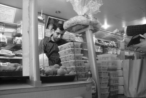 Buying some samosas. Brick Lane 2010.