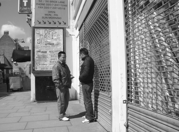 Conversation on Brick Lane. Spitalfields, East London 2010.