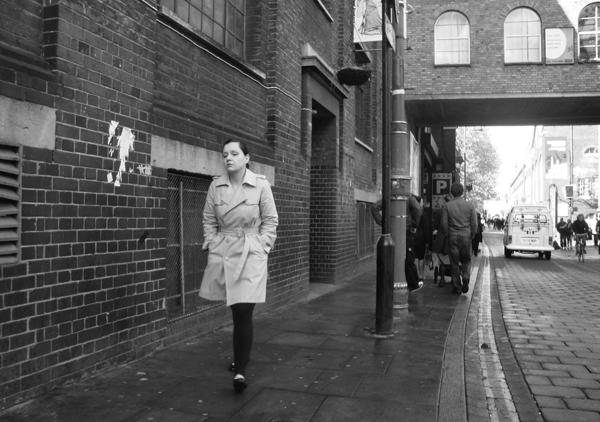 Woman in a white coat. Brick Lane. Spitalfields, East London 2010.