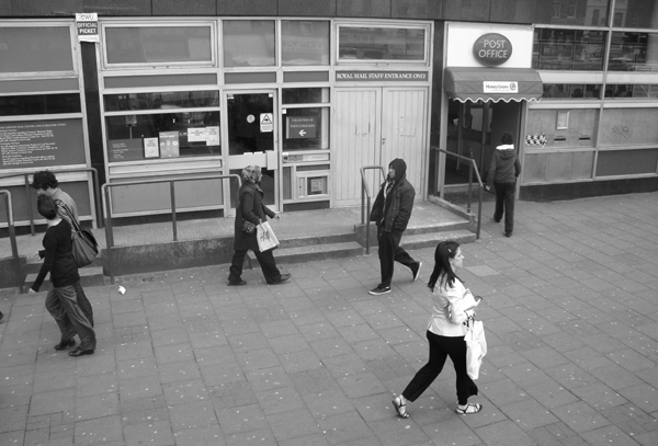 Passing the post office. Whitechapel Road. East London 2010.