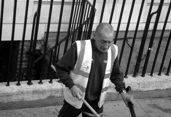Street cleaner. Mile End Road. East London 2010.