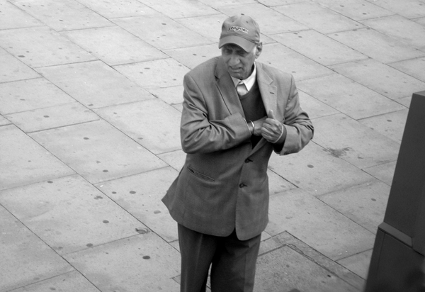 Man with a hat. Mile End Road. East London 2010.
